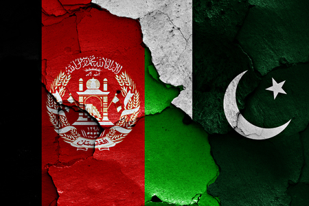 afghan flag: flags of Afghanistan and Pakistan painted on cracked wall