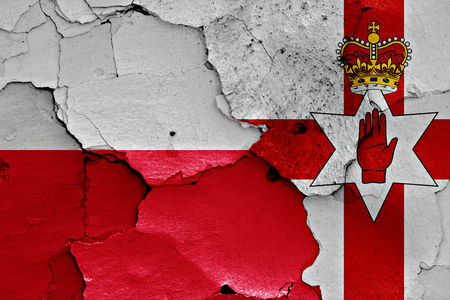 cracked wall: flags of Poland and Northern Ireland painted on cracked wall