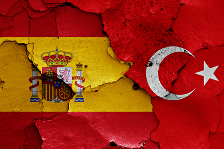 cracked wall: flags of Spain and Turkey painted on cracked wall