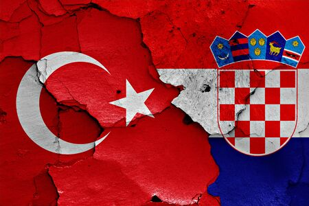 cracked wall: flags of Turkey and Croatia painted on cracked wall