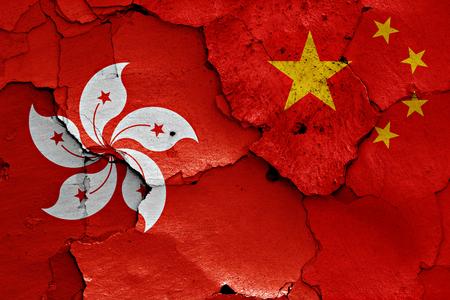 cracked wall: flags of Hong Kong and China painted on cracked wall Stock Photo