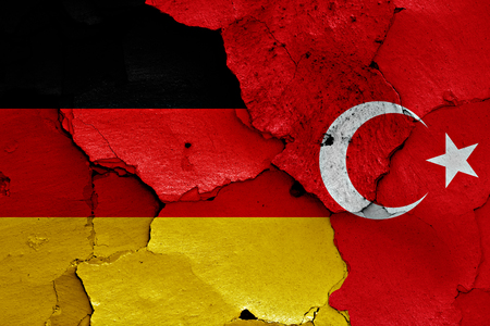flags of Germany and Turkey painted on cracked wall Banque d'images
