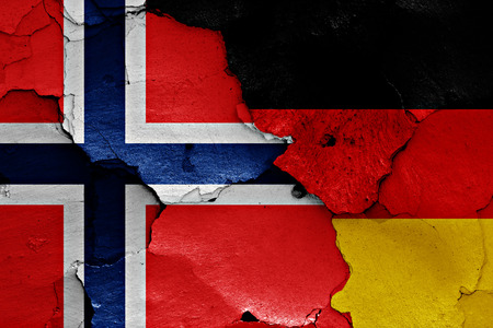 cracked wall: flags of Norway and Germany painted on cracked wall