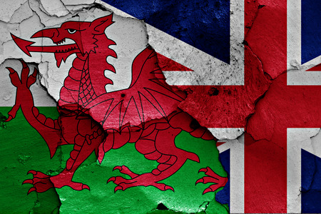 referendum: flags of Wales and UK painted on cracked wall Stock Photo
