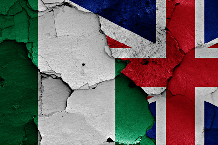 flags of Nigeria and UK painted on cracked wall
