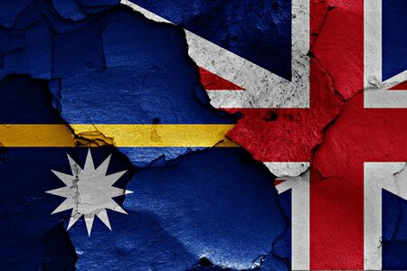 flags of Nauru and UK painted on cracked wall