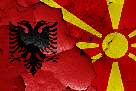 flags of Albania and Macedonia painted on cracked wall Stock Photo