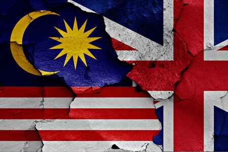 referendum: flags of Malaysia and UK painted on cracked wall