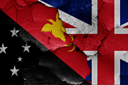 referendum: flags of Papua New Guinea and UK painted on cracked wall