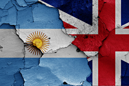referendum: flags of Argentina and UK painted on cracked wall Stock Photo
