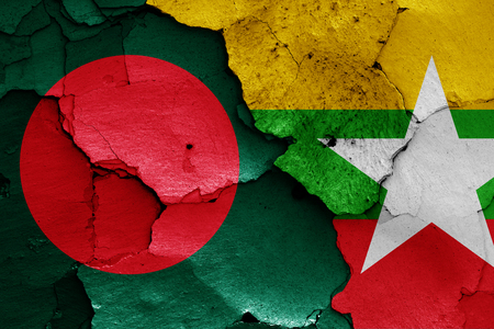 national flag bangladesh: flags of Bangladesh and Myanmar painted on cracked wall Stock Photo