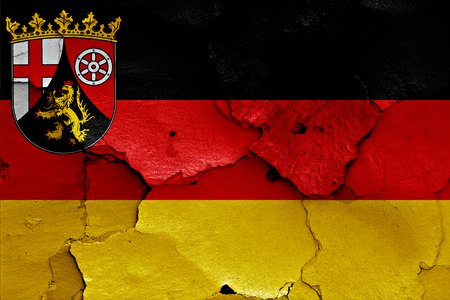 cracked wall: flags of Rhineland Palatinate and Germany painted on cracked wall