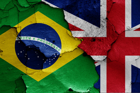 flags of Brazil and UK painted on cracked wall