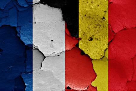cracked wall: flags of France and Belgium painted on cracked wall Stock Photo