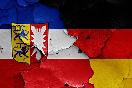 cracked wall: flags of Schleswig Holstein and Germany painted on cracked wall