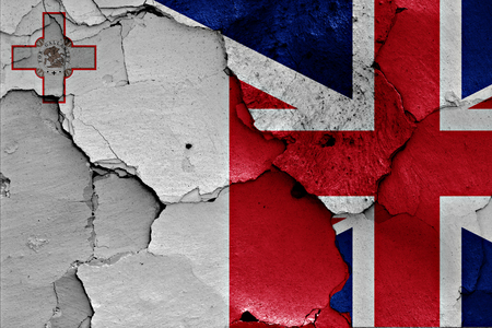referendum: flags of Malta and UK painted on cracked wall Stock Photo