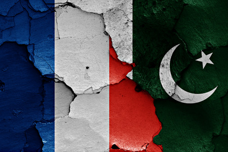 relationship breakup: flags of France and Pakistan painted on cracked wall