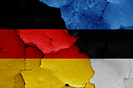 cracked wall: flags of Germany and Estonia painted on cracked wall