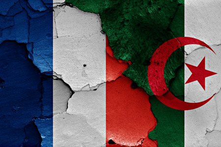 algerian flag: flags of France and Algeria painted on cracked wall