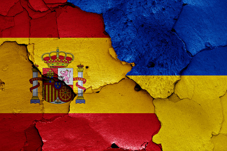 flags of Spain and Ukraine painted on cracked wall Stock Photo