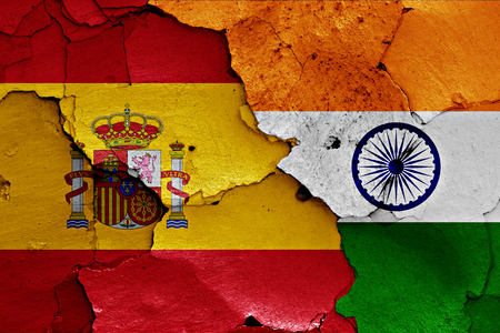 flags of Spain and India painted on cracked wall