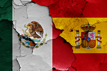 flags of Mexico and Spain painted on cracked wall Stock Photo