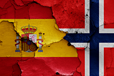 flags of Spain and Norway painted on cracked wall