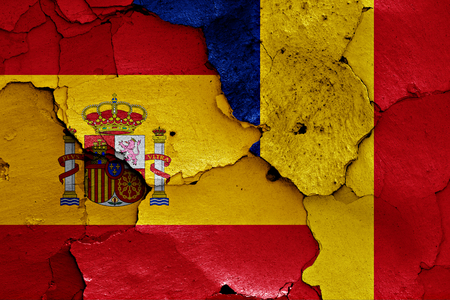 flags of Spain and Romania painted on cracked wall