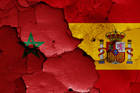 flags of Morocco and Spain painted on cracked wall Stock Photo