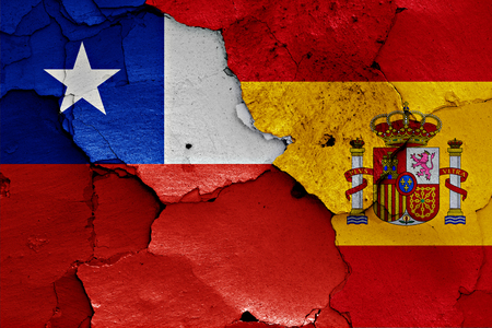 flags of Chile and Spain painted on cracked wall Stock Photo