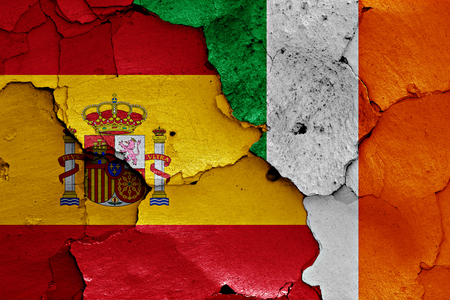 flags of Spain and Ireland painted on cracked wall