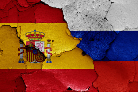 flags of Spain and Russia painted on cracked wall