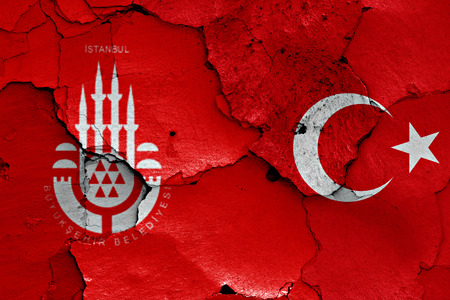 flags of Istanbul and Turkey painted on cracked wall