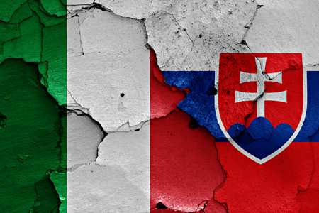 flags of Italy and Slovakia painted on cracked wall Stock Photo
