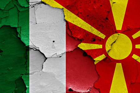 flags of Italy and Macedonia painted on cracked wall Stock Photo