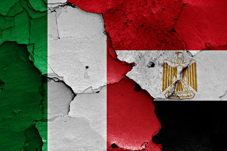 flags of Italy and Egypt painted on cracked wall