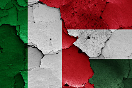 flags of Italy and Hungary painted on cracked wall