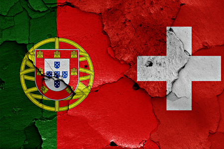 flags of Portugal and Switzerland painted on cracked wall Stock Photo