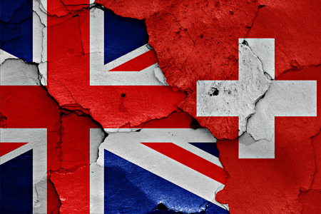 flags of UK and Switzerland painted on cracked wall