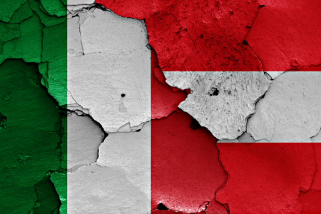 flags of Italy and Austria painted on cracked wall Stock Photo