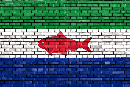 flag of Federal Dependencies of Venezuela painted on brick wall 写真素材