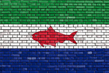 flag of Federal Dependencies of Venezuela painted on brick wall 写真素材