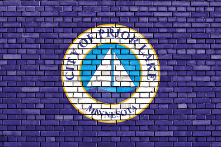 flag of Prior Lake painted on brick wall