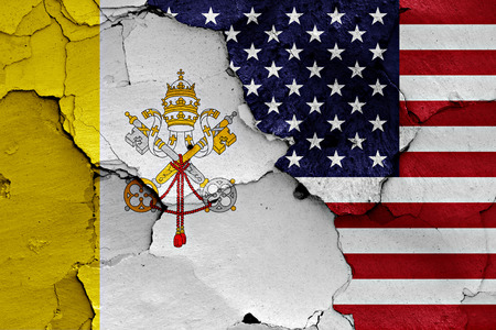 flag of Vatican and USA painted on cracked wall