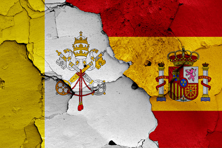 flag of Vatican and Spain  painted on cracked wall Stock Photo