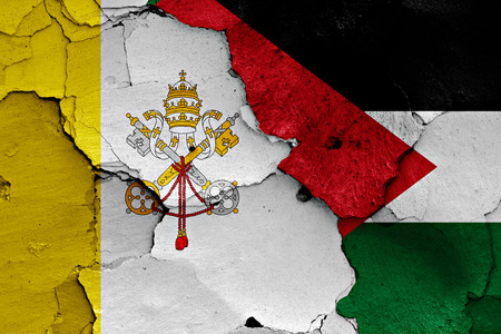 flag of Vatican and Palestine painted on cracked wall