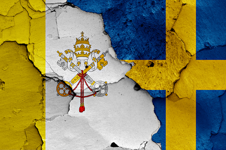 flag of Vatican and Sweden painted on cracked wall Stock Photo