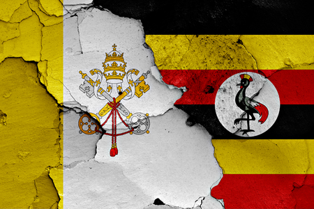 flag of Vatican and Uganda painted on cracked wall