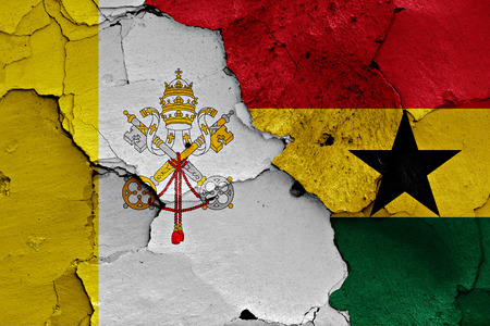 flag of Vatican and Ghana painted on cracked wall Stock Photo