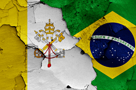 flag of Vatican and Brazil painted on cracked wall
